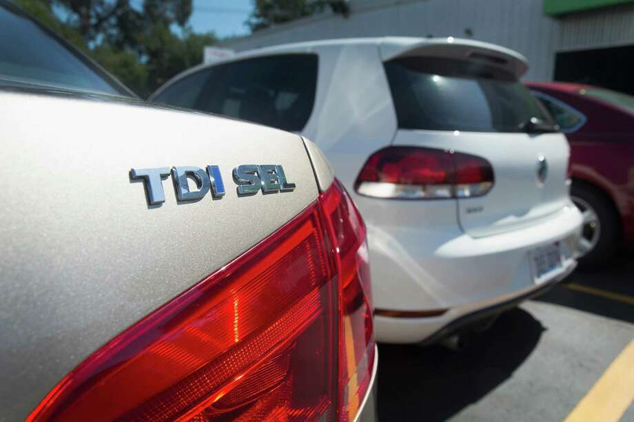 A 2015 Volkswagen Passat with the TDI Clean Diesel motor is offered for sale last month at a dealership Evanston, Illinois. The Volkswagen brand struggled after Sept. 18, when the U.S. government revealed that nearly 500,000 VW and Audi diesels sold in the U.S. had software that let them cheat on emissions tests. Photo: Scott Olson /Getty Images / 2015 Getty Images