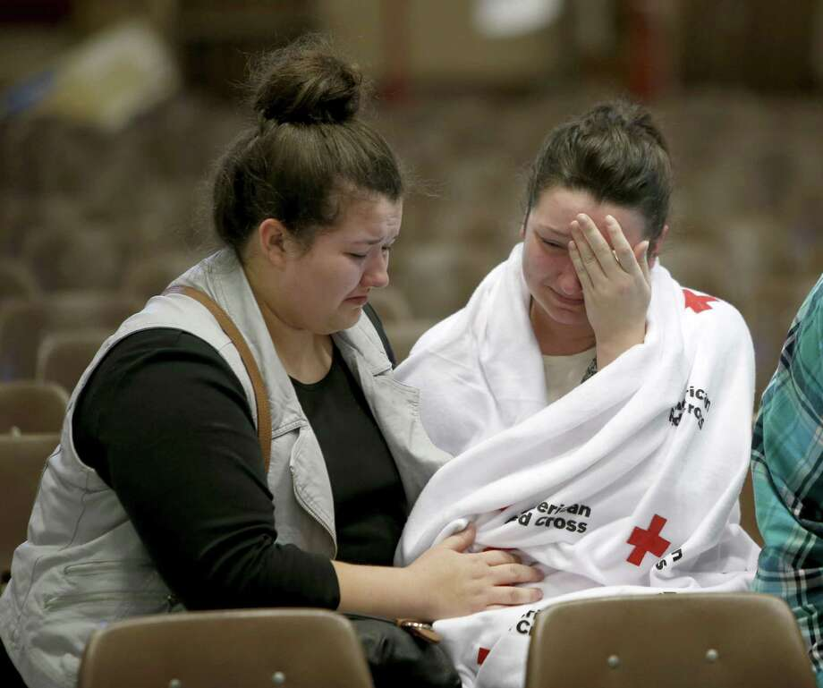 Hannah Miles, right, sits with her sister Hailey after Hannah was reunited with her family in Roseburg, Ore., on Thursday, Oct. 1, 2015, after a deadly shooting at Umpqua Community College. (Andy Nelson/The Register-Guard via AP) MANDATORY CREDIT Photo: Andy Nelson, AP / The Register-Guard