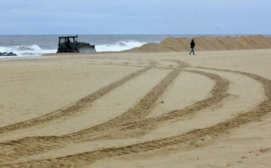 These 8-foot dunes of sand were erected Thursday to protect against potential flooding from Hurricane Joaquin in Belmar, N.J. East Coast officials began alerting the public to be ready for heavy rains, sustained winds and possible flooding. Photo: YANA PASKOVA, STR / NYTNS
