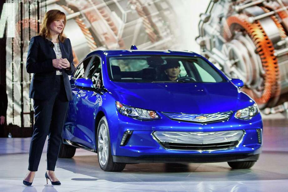 General Motors CEO Mary Barra talks about the 2016 Chevrolet Volt hybrid car at this year's North American International Auto Show in Detroit. GM announced it would run a fleet of self-driving plug-in gas-electric hybrid Chevrolet Volts on its giant technical center campus in the Detroit suburb of Warren, Michigan, by late next year. Photo: Associated Press File Photo / FR143848 AP