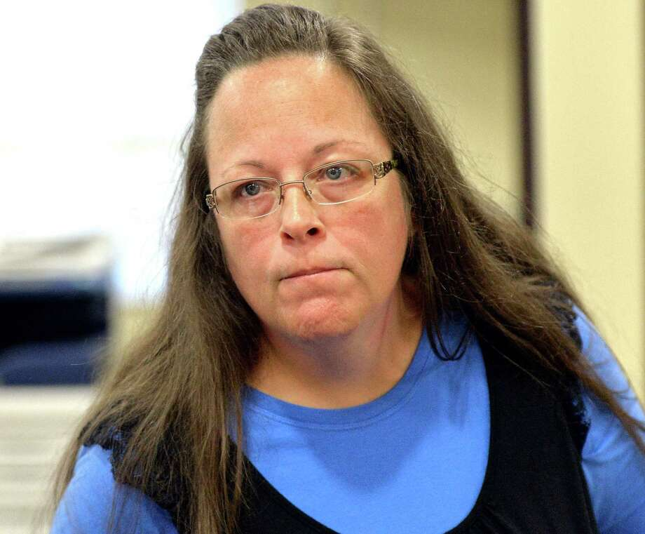 FILE - In this Tuesday, Sept. 1, 2015, file photo, Rowan County Clerk Kim Davis listens to a customer following her office's refusal to issue marriage licenses at the Rowan County Courthouse in Morehead, Ky. Davis, who spent five days in jail for defying a series of federal court orders, filed a lawsuit against Gov. Steve Beshear, alleging he violated her religious freedom by asking clerks to comply with the U.S. Supreme Court's decision, which effectively legalized gay marriage across the nation. Beshear reiterated a request Tuesday, Sept. 29, that a judge toss the suit. (AP Photo/Timothy D. Easley, File) Photo: Timothy D. Easley, FRE / FR43398 AP