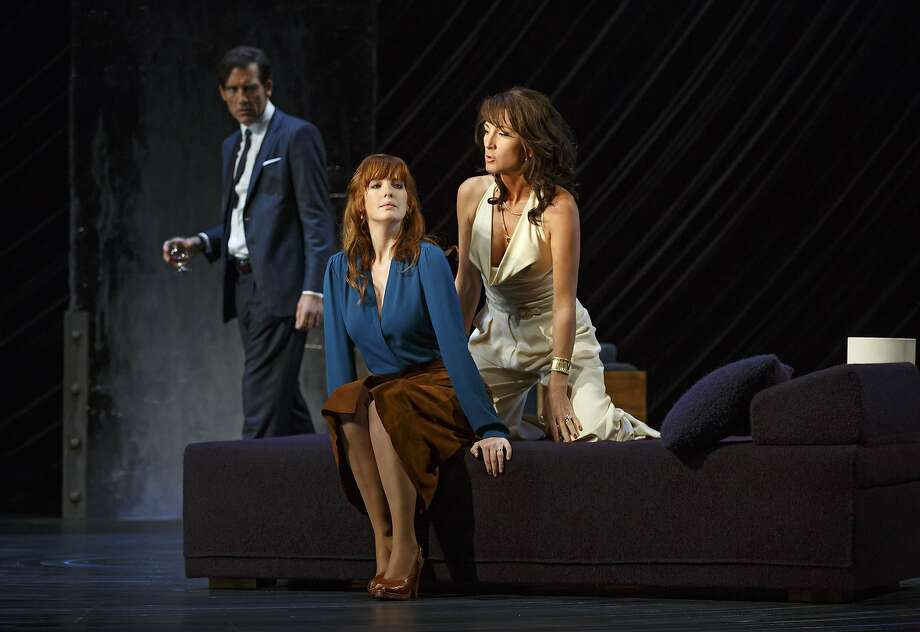 "In this image released by Polk & Co., Clive Owen, from left, Kelly Reilly and Eve Best appear during a performance of Harold Pinter's ""Old Times."" In the 70-minute ""Old Times,"" a game of power and possession is played out between a married couple and the wife's former flatmate, who she has not seen in 20 years. (Joan Marcus/Polk & Co. via AP) Photo: Joan Marcus, Associated Press"
