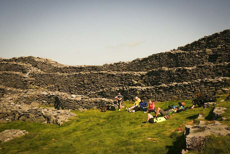 The Black Fort is one of 50 monuments of Christian, pre-Christian and Celtic mythological heritage on Inis Mor. Cyclists put down bikes to reach sites on foot. Photo: Jill K. Robinson, Special To The Chronicle