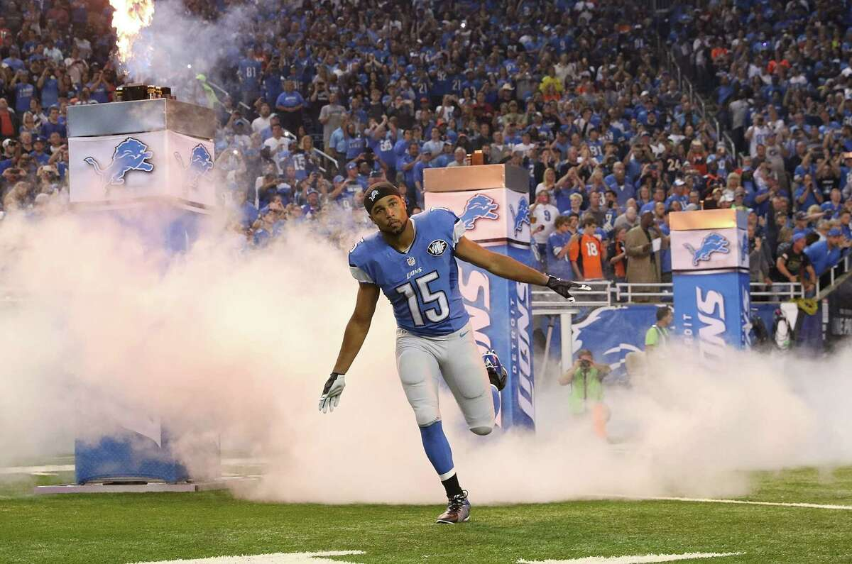 DETROIT, MI - SEPTEMBER 27: Golden Tate #15 of the Detroit Lions leads his team onto the field prior to the start of the game against the Denver Broncos on September 27, 2015 at Ford Field in Detroit, Michigan. The Broncos defeated the Lions 24-12.