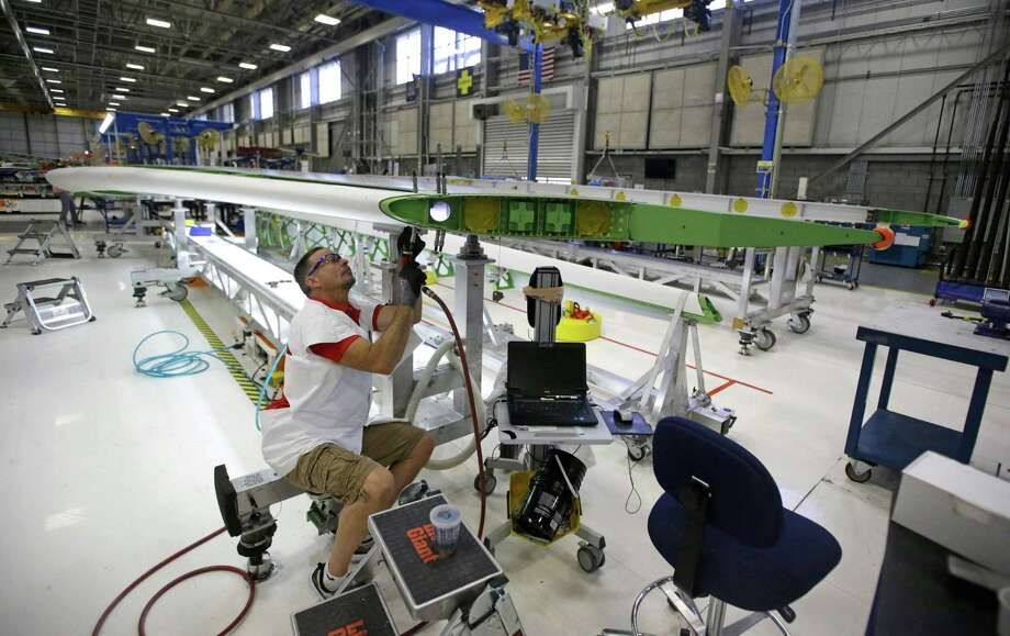 In this Sept. 3, 2015, photo, a Boeing employee works on a horizontal stabilizer for a Boeing 787 Dreamliner, at Boeing in Salt Lake City. The Institute for Supply Management, a trade group of purchasing managers, issues its index of manufacturing activity for September on Thursday, Oct. 1. (AP Photo/Rick Bowmer) ORG XMIT: NYBZ118 Photo: Rick Bowmer / AP