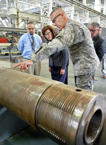 Commander of the Watervliet Arsenal Colonel Lee H. Schiller, right, discusses production of the 120mm canon with Lt. Gov. Kathy Hochul during her tour of the arsenal Thursday Oct. 1, 2015 in Watervliet, NY. At left is chief of production control Terry Van Vranken.  (John Carl D'Annibale / Times Union) Photo: John Carl D'Annibale / 10033580A