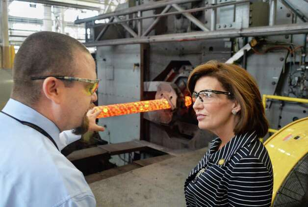 Chief of production control Terry Van Vranken, left, explains how their rotary forge operates to Lt. Gov. Kathy Hochul during her tour of the Watervliet Arsenal Thursday Oct. 1, 2015 in Watervliet, NY.  (John Carl D'Annibale / Times Union) Photo: John Carl D'Annibale / 10033580A