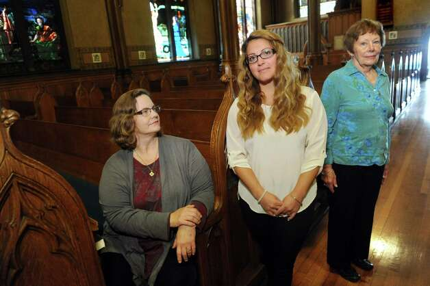 K. Michelle Doyle, a midwife, left, joins Jaclyn Damiano of Wynantskill, center, and Marianne Gorchov of Averill Park on Tuesday, Sept. 29, 2015, at St. Paul's Episcopal Church in Troy, N.Y. The women are preparing a service for those who have experienced perinatal loss, from unsuccessful pregnancies or the death of a child within the first year of life. (Cindy Schultz / Times Union) Photo: Cindy Schultz / 00033541A