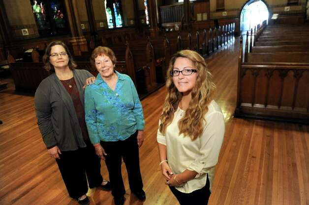 K. Michelle Doyle, a midwife, left, joins Marianne Gorchov of Averill Park, center, and Jaclyn Damiano of Wynantskill on Tuesday, Sept. 29, 2015, at St. Paul's Episcopal Church in Troy, N.Y. The women are preparing a service for those who have experienced perinatal loss, from unsuccessful pregnancies or the death of a child within the first year of life. (Cindy Schultz / Times Union) Photo: Cindy Schultz / 00033541A
