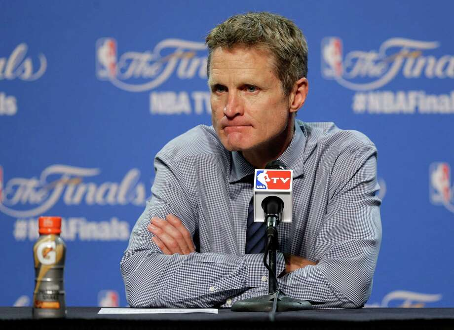 FILE - In this  Wednesday, June 10, 2015 file photo, Golden State Warriors head coach Steve Kerr listens to a question during a press conference following Game 3 of basketball's NBA Finals against the Cleveland Cavaliers in Cleveland.  Golden State Warriors coach Steve Kerr will take a leave of absence as he recovers from back surgery and will be replaced on an interim basis by Luke Walton. The Warriors announced Thursday, Oct. 1, 2015 that Kerr will need time off for rehabilitation and recovery. (AP Photo/Tony Dejak, File) ORG XMIT: NY184 Photo: Tony Dejak / AP