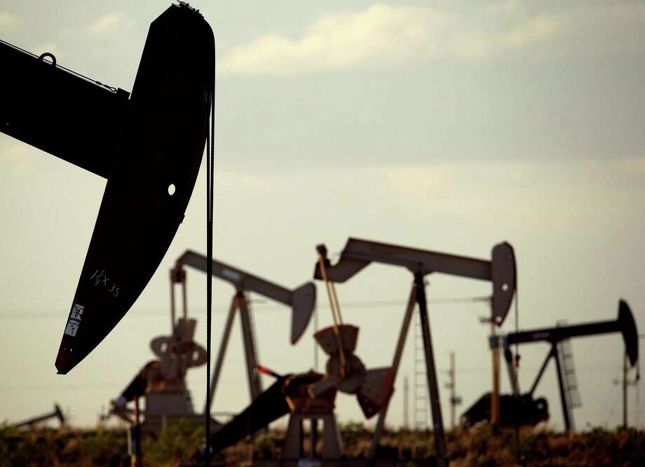 Pumpjacks work in a field near Lovington, N.M. Moody's projects that oil prices will rise slowly, to an average for West Texas Intermediate crude of $48 a barrel in 2016 and $55 in 2017. Photo: Associated Press File Photo / AP