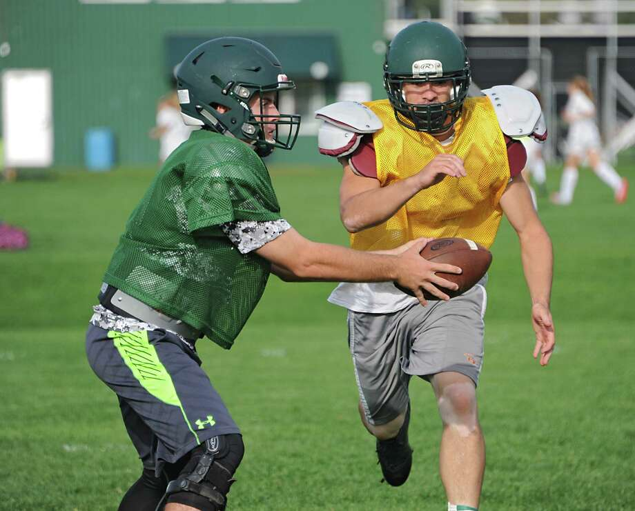 Schalmont junior QB Jake Defayette, left, hands off the football during practice at Schalmont High School on Thursday, Oct. 1, 2015 in Rotterdam, N.Y. (Lori Van Buren / Times Union) Photo: Lori Van Buren / 10033585A