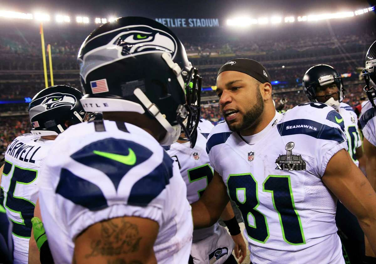 EAST RUTHERFORD, NJ - FEBRUARY 02: Wide receiver Golden Tate #81 of the Seattle Seahawks celebrates the second half kickoff return by wide receiver Percy Harvin #11 during Super Bowl XLVIII at MetLife Stadium on February 2, 2014 in East Rutherford, New Jersey.