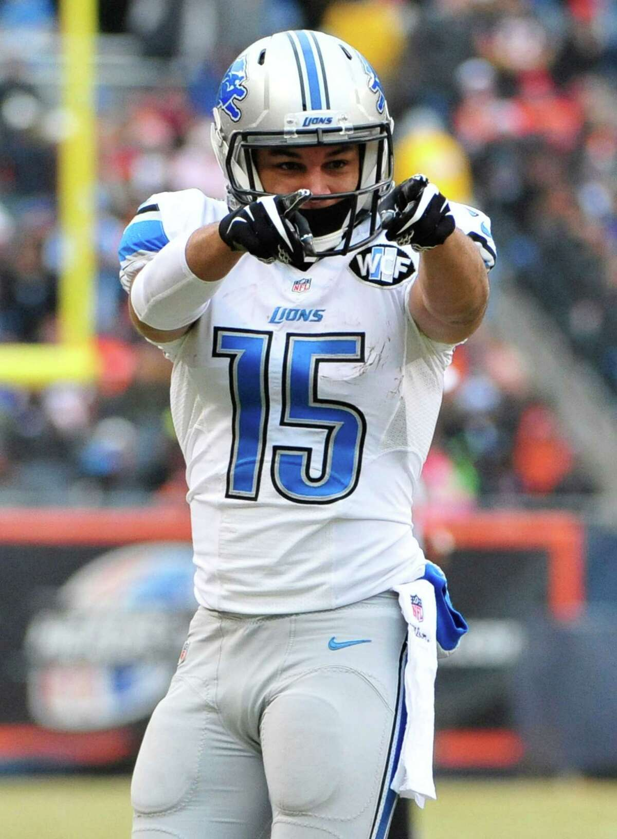 CHICAGO, IL - DECEMBER 21: Golden Tate #15 of the Detroit Lions points after making a first down during the second quarter of a game against the Chicago Bears at Soldier Field on December 21, 2014 in Chicago, Illinois.