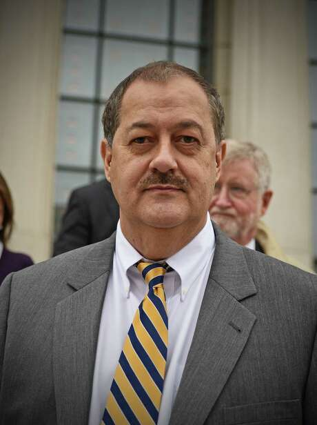 Don Blankenship makes his way out of the Robert C. Byrd United States Courthouse on the first day of jury selection in Charleston, W.Va., on Thursday, Oct. 1, 2015. Former Massey Energy CEO Blankenship appeared for the start of his federal trial on charges that he conspired to break safety laws and lied to financial regulators about (AP Photo/Tyler Evert) Photo: Tyler Evert Tyler Evert AP, FRE / FR170609 AP