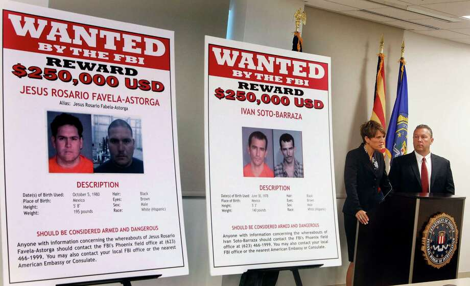 FILE - In this July 9, 2012, file photo, with wanted posters off to the side, Laura E. Duffy, United States Attorney Southern District of California, and FBI Special Agent in Charge, James L. Turgal, Jr., right, announce the indictments on five suspects involved in the death of U.S. Border Patrol agent Brian Terry in Tucson, Ariz. Two men charged with murder in the death of a U.S. Border Patrol agent that revealed the bungled gun-smuggling investigation known as Fast and Furious go on trial Wednesday, Sept. 23, 2015. Jesus Leonel Sanchez-Meza, also known as Lionel Portillo-Meza, and Ivan Soto-Barraza will be the first to face trial. (AP Photo/Ross D. Franklin, File) Photo: Ross D. Franklin, STF / Associated Press / AP