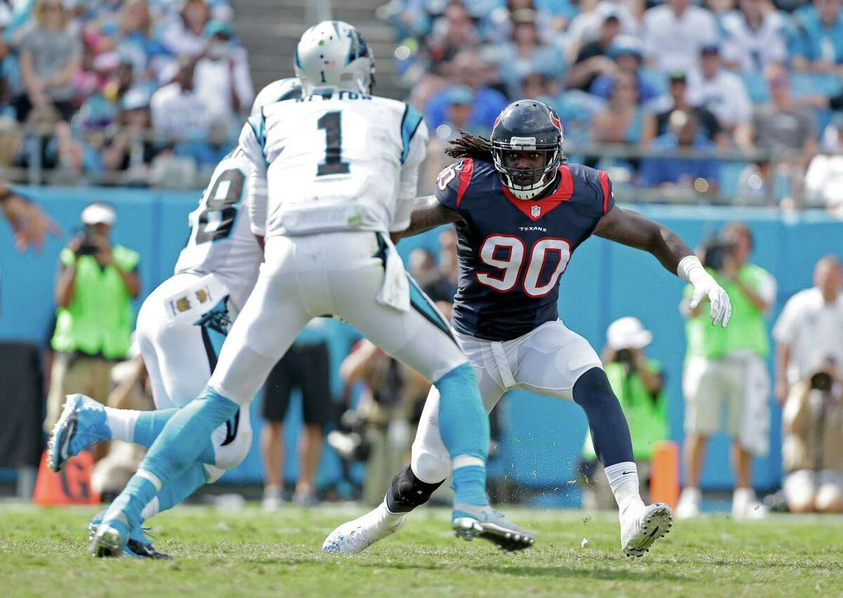 Houston Texans' Jadeveon Clowney (90) looks to stop the Carolina Panthers' Jonathan Stewart (28) and Cam Newton (1) during the second half of an NFL football game in Charlotte, N.C., Sunday, Sept. 20, 2015. The Panthers won 24-17.