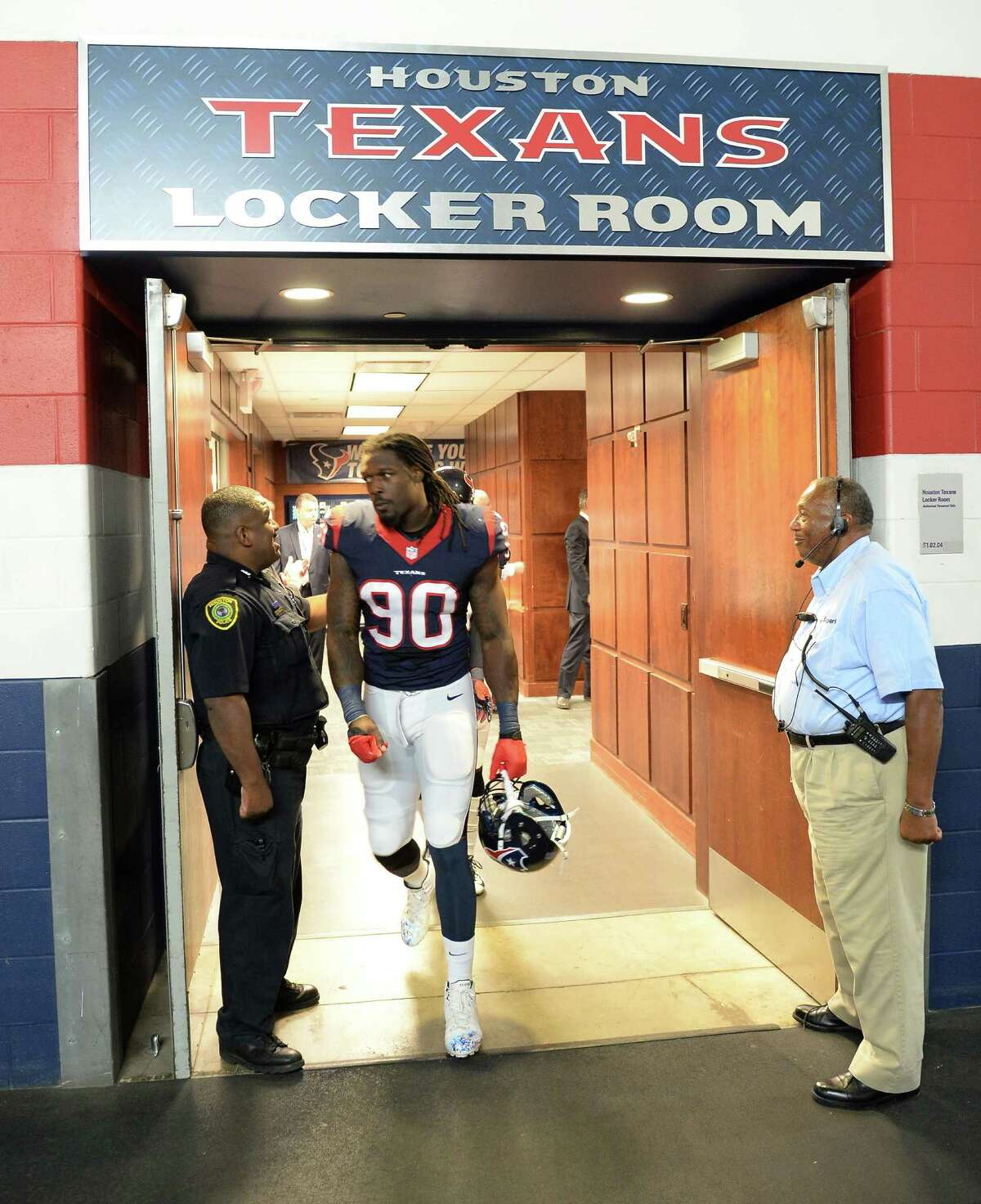 Houston Texans outside linebacker Jadeveon Clowney (90) leaves the locker room before an NFL football game Sunday, Sept. 27, 2015, in Houston.