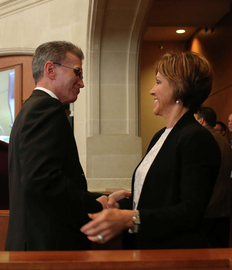San Antonio City Manager Sheryl Sculley congratulated William McManus after he's nomination as the next San Antonio Police Department chief is unanimously approved by City Council, Thursday, Oct. 1, 2015. McManus quit the position to take the head of security at CPS Energy last year. Photo: JERRY LARA, Staff / San Antonio Express-News / © 2015 San Antonio Express-News