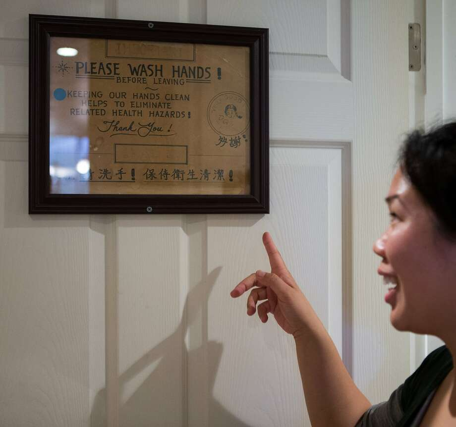 Julie Ho retells an anecdote about the well-loved 1960's owner of Sam Wo, Edsel Ford Fong, who used to yell at patrons who did not wash their hands after leaving the restrooms. Photo: Nathaniel Y. Downes, The Chronicle