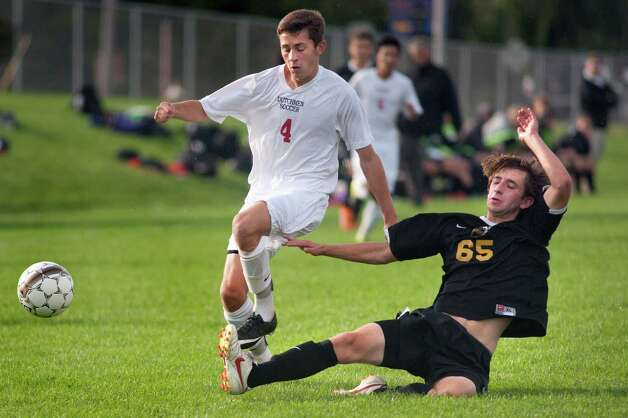 Ballston Spa's Noah Grenier, right, kicks the ball away from Guilderland's Jeremy Collen during their soccer game on Thursday, Oct. 1, 2015, at Guilderland High in Guilderland N.Y. (Cindy Schultz / Times Union) Photo: Cindy Schultz / 00033520A