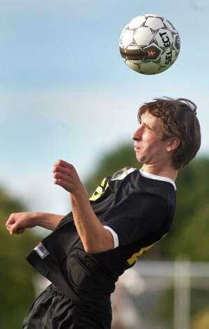 Ballston Spa's Noah Grenier hits a header during their soccer game against Guilderland on Thursday, Oct. 1, 2015, at Guilderland High in Guilderland N.Y. (Cindy Schultz / Times Union) Photo: Cindy Schultz / 00033520A