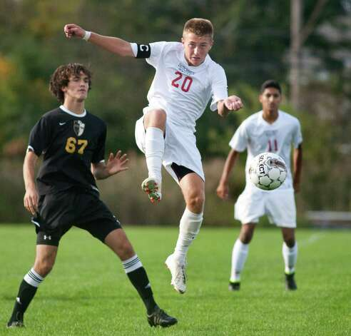 Guilderland's Tyler Landry, center, passes the ball as Ballston Spa's Connor DeFilippis, left, defends during their soccer game on Thursday, Oct. 1, 2015, at Guilderland High in Guilderland N.Y. (Cindy Schultz / Times Union) Photo: Cindy Schultz / 00033520A