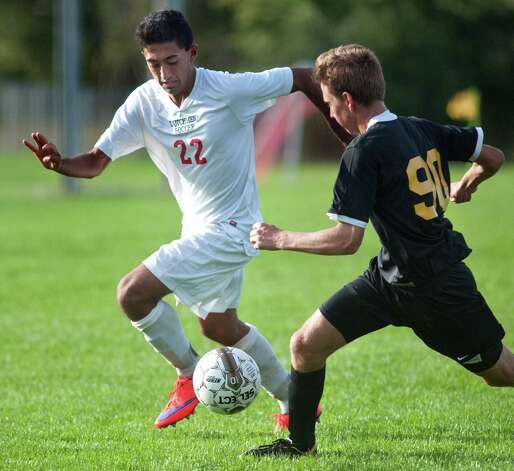 Guilderland's Kieran Thapalia, left, controls the ball as Ballston Spa's Aviles Meyer defends during their soccer game on Thursday, Oct. 1, 2015, at Guilderland High in Guilderland N.Y. (Cindy Schultz / Times Union) Photo: Cindy Schultz / 00033520A