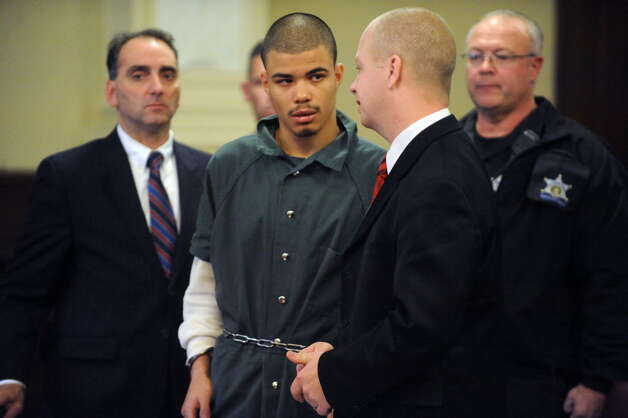 Gabriel Vega, center, charged with the murder of Vanessa Milligan, talks with his public defender William Roberts, right, during his bail hearing in Rensselaer County Court on Friday Oct. 31, 2014 in Troy, N.Y. (Michael P. Farrell/Times Union)