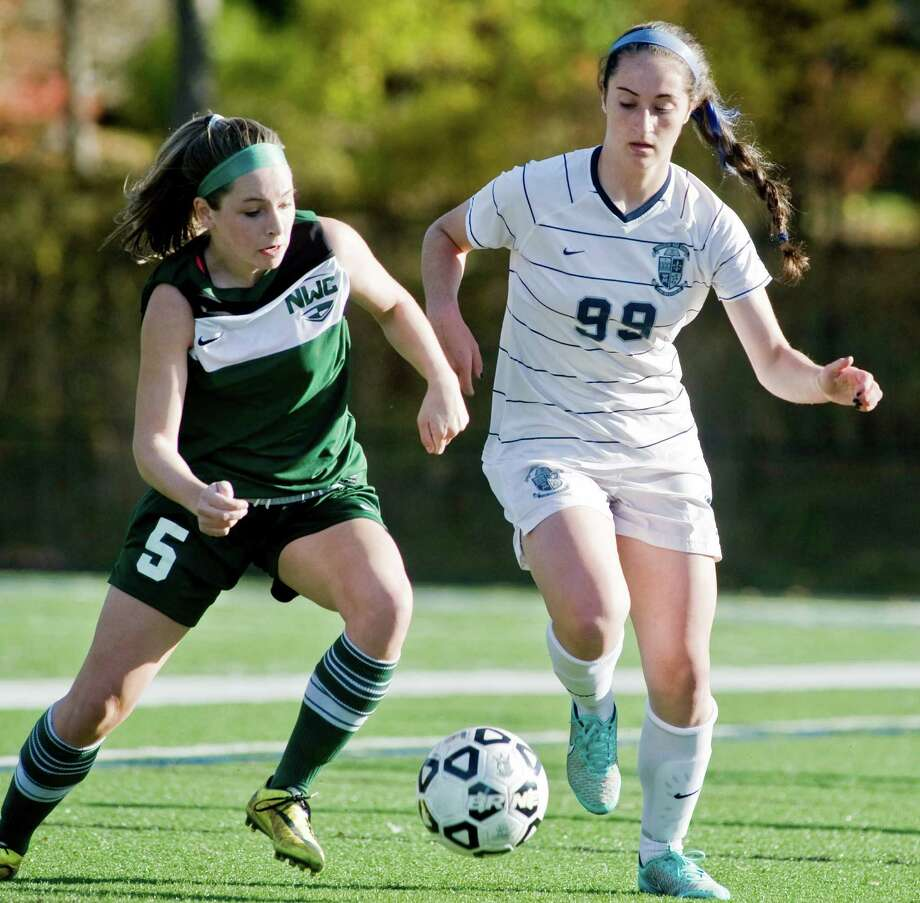 FILE PHOTO: Northwest Catholic High School's Kirsten Armetta and Immaculate High School's Hailey Davis chase the ball in the Class L girls soccer quarterfinals played at Immaculate. Monday, Nov. 10, 2014 Photo: Scott Mullin / Scott Mullin / The News-Times Freelance