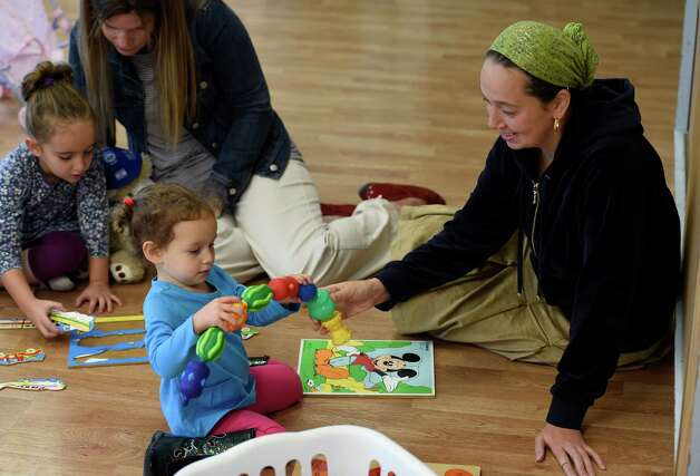 Zina Gottesman enjoys some one on one time with daughter Meira Reznik, 2, in the PJ Library at the Albany Jewish Community Center Thursday morning Oct. 1, 2015 in Albany, N.Y. The PJ Library is run every Thursday morning from 9:15-11:15.          (Skip Dickstein/Times Union) Photo: SKIP DICKSTEIN / 00033526A