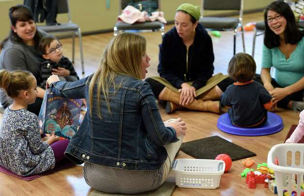 Amy Drucker reads a book to parents and children gathered at the PJ Library which is open to all for kids activities at the Albany Jewish Community Center Thursday morning Oct. 1, 2015 in Albany, N.Y.   (Skip Dickstein/Times Union) Photo: SKIP DICKSTEIN / 00033526A