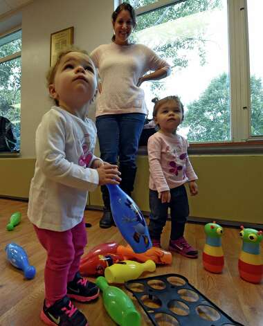Hila Belsky keeps an eye on her 19 month old twins Daniele, left and Lea at the PJ Library which is open to all for kids activities at the Albany Jewish Community Center Thursday morning Oct. 1, 2015 in Albany, N.Y.   (Skip Dickstein/Times Union) Photo: SKIP DICKSTEIN / 00033526A