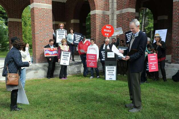 Scenic Hudson President Ned Sullivan, right, prepare his speech during a press conference and protest on the state of the GE Hudson River PCB cleanup on Thursday Oct. 1, 2015, at Saratoga Spa State Park in Saratoga Springs , N.Y.  (Michael P. Farrell/Times Union) Photo: Michael P. Farrell / 10033572A