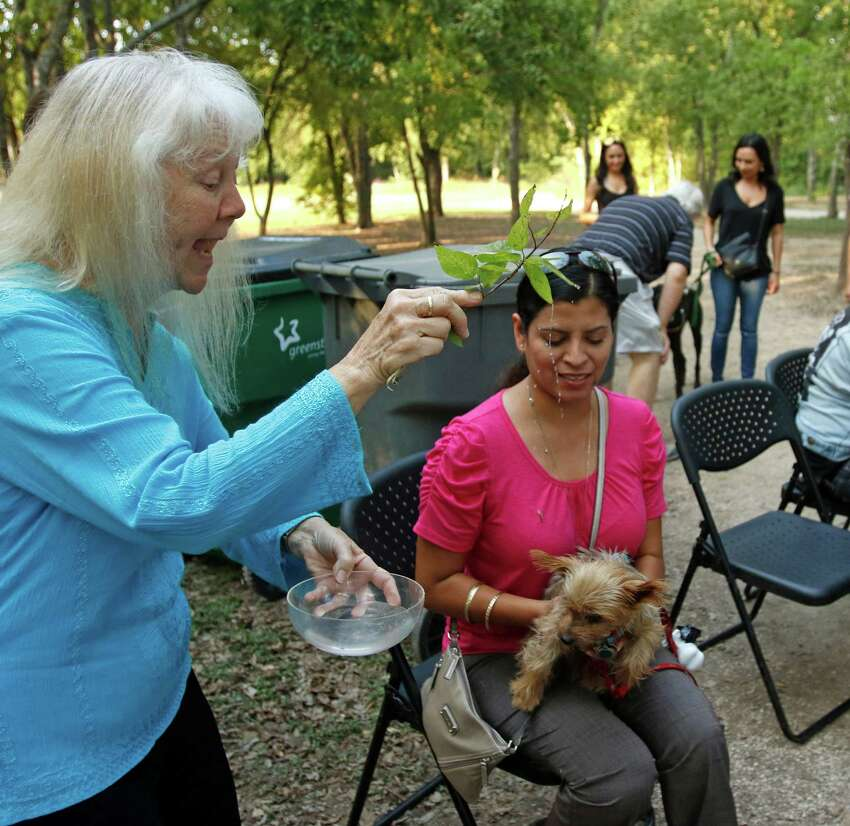 Sister Martha Ann Kirk,CCVI blesses Maricruz Rangel with her dog Toby, a Yorkie. The University of the Incarnate Word (UIW) invites the San Antonio community to the annual Blessing of the Animals celebrating the feast of St. Francis of Assisi on Thursday, Oct 1,2015.