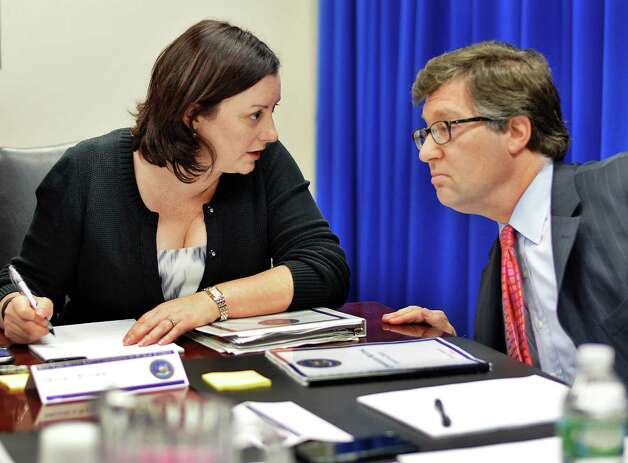 General counsel Monica Stamm, left, and JCOPE chair Daniel Horwitz confer during a regular meeting of  commissioners Tuesday August 4, 2015 in Albany, NY.  (John Carl D'Annibale / Times Union) Photo: John Carl D'Annibale / 10032880A