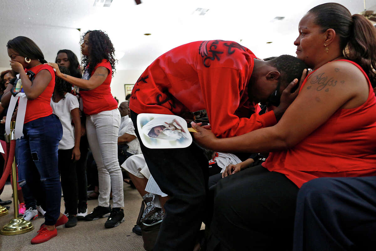 Tam-Monta Hastings, 17, cries into the chest of Olivia Fenner, the mother of Tru Sincere Trusty, 16, during Trusty's funeral at Tree Mount Temple Church in San Antonio on Thursday, Oct. 1, 2015. Trusty was shot and killed last Saturday.