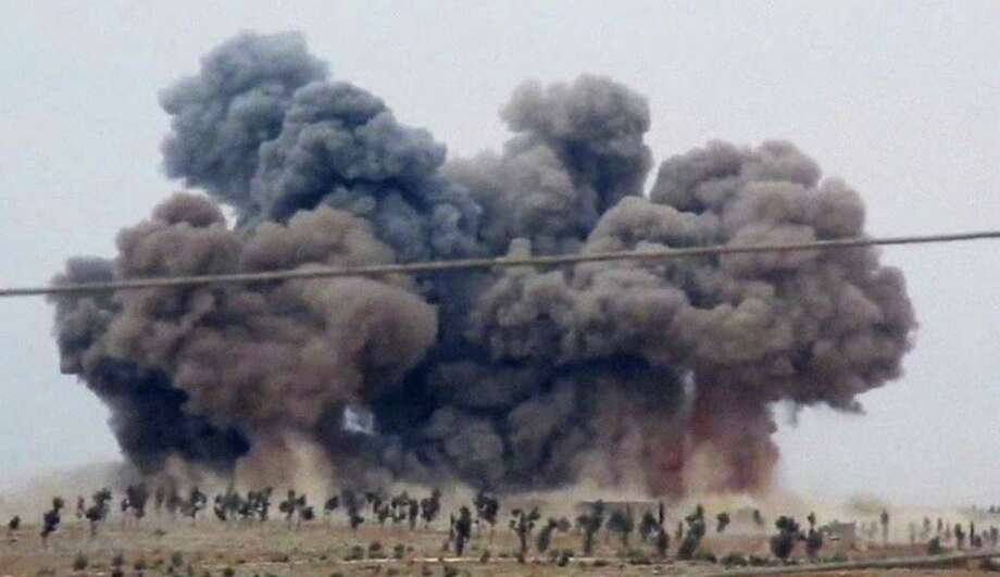 In this image made from video provided by Hadi Al-Abdallah, which has been verified and is consistent with other AP reporting, smoke rises after airstrikes in Kafr Nabel of the Idlib province, western Syria, Thursday, Oct. 1, 2015. Russian jets carried out a second day of airstrikes in Syria Thursday, but there were conflicting claims about whether they were targeting Islamic State and al-Qaeda militants or trying to shore up the defenses of President Bashar Assad. (Hadi Al-Abdallah via AP) ORG XMIT: CAIHK101 Photo: Hadi Al-Abdallah / Hadi Al-Abdallah