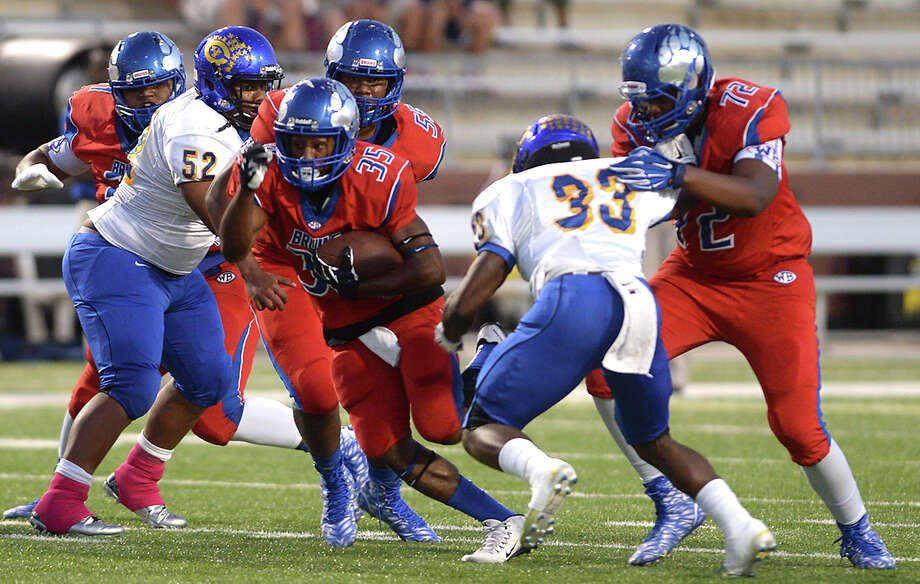 West Brook's Nick Sorrell finds an opening in Channelview's defense as he runs the ball during Thursday night's match-up at the Thomas Center in Beaumont.  Photo taken Thursday, October 1, 2015  Photo by Kim Brent Photo: Kim Brent / Beaumont Enterprise