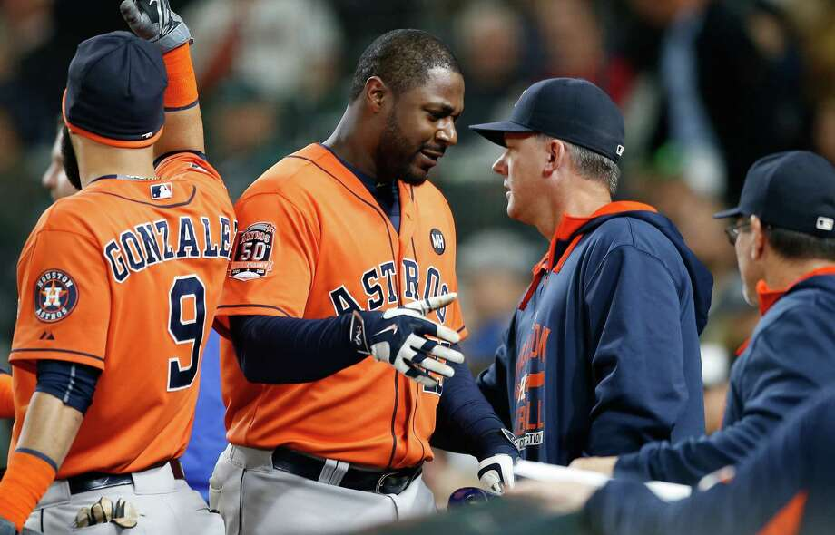 Chris Carter, center, has validated management's faith in him, with his latest big hit a game-tying three-run homer in Wednesday's 7-6 victory over the Mariners. Photo: Otto Greule Jr, Stringer / 2015 Getty Images