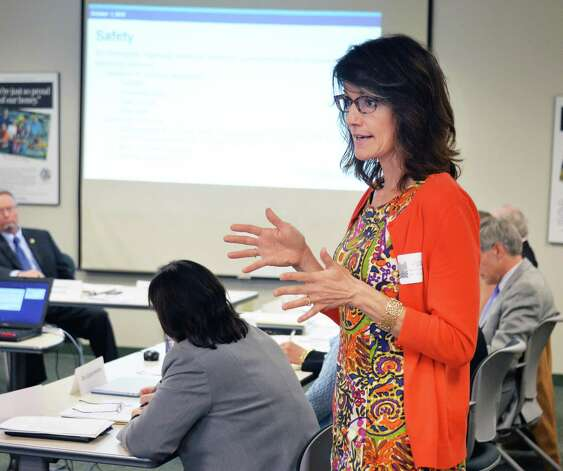 Ms. Elizabeth Novak of the New York State Thruway Authority/Canal Corporation speaks at a meeting of state officials brainstorming on ways to improve bee habitatNYS Department of Agriculture & Markets Thursday Oct. 1, 2015 in Colonie, NY.  (John Carl D'Annibale / Times Union) Photo: John Carl D'Annibale / 10033589A