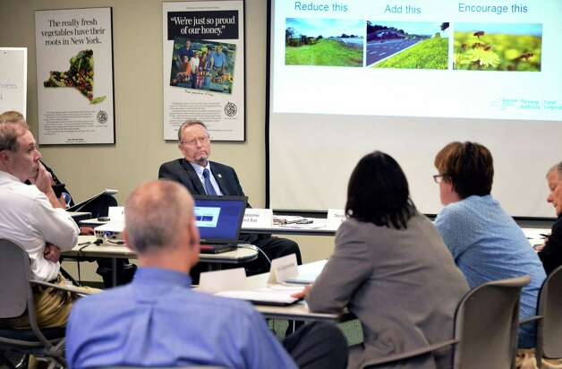 Commissioner Richard A. Ball, center, chairs a meeting of state officials  to brainstorm on ways to improve bee habitatNYS Department of Agriculture & Markets Thursday Oct. 1, 2015 in Colonie, NY.  (John Carl D'Annibale / Times Union) Photo: John Carl D'Annibale / 10033589A