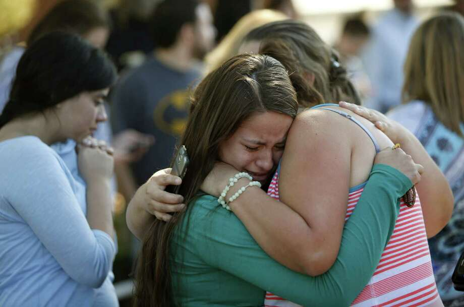 Jessica Vazquez, left, hugs her aunt, Leticia Acaraz, as they await word on Acaraz's daughter after a deadly shooting at Umpqua Community College, in Roseburg, Ore., on Thursday, Oct. 1, 2015. (Andy Nelson/The Register-Guard via AP) MANDATORY CREDIT  ORG XMIT: OREUG105 Photo: Andy Nelson / The Register-Guard