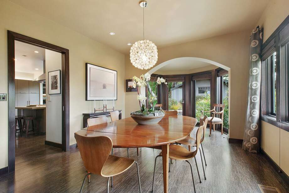 The dining room sits off the kitchen and foyer and opens to the garden. Photo: OpenHomesPhotography.com