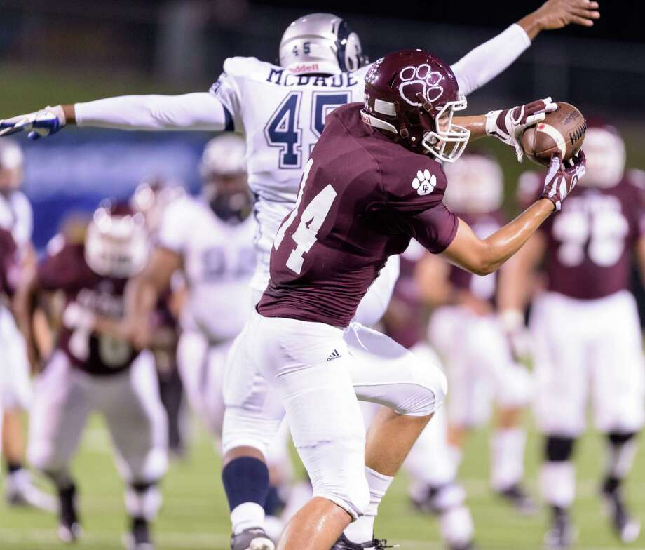 Cy-Fair 19, Cy Ridge 10Cy-Fair receiver Sam Cole (14) makes a reception during the Bobcats' 19-10 win over Cypress Ridge on Thursday at Pridgeon Field. Photo: Wilf Thorne / © 2015 Houston Chronicle