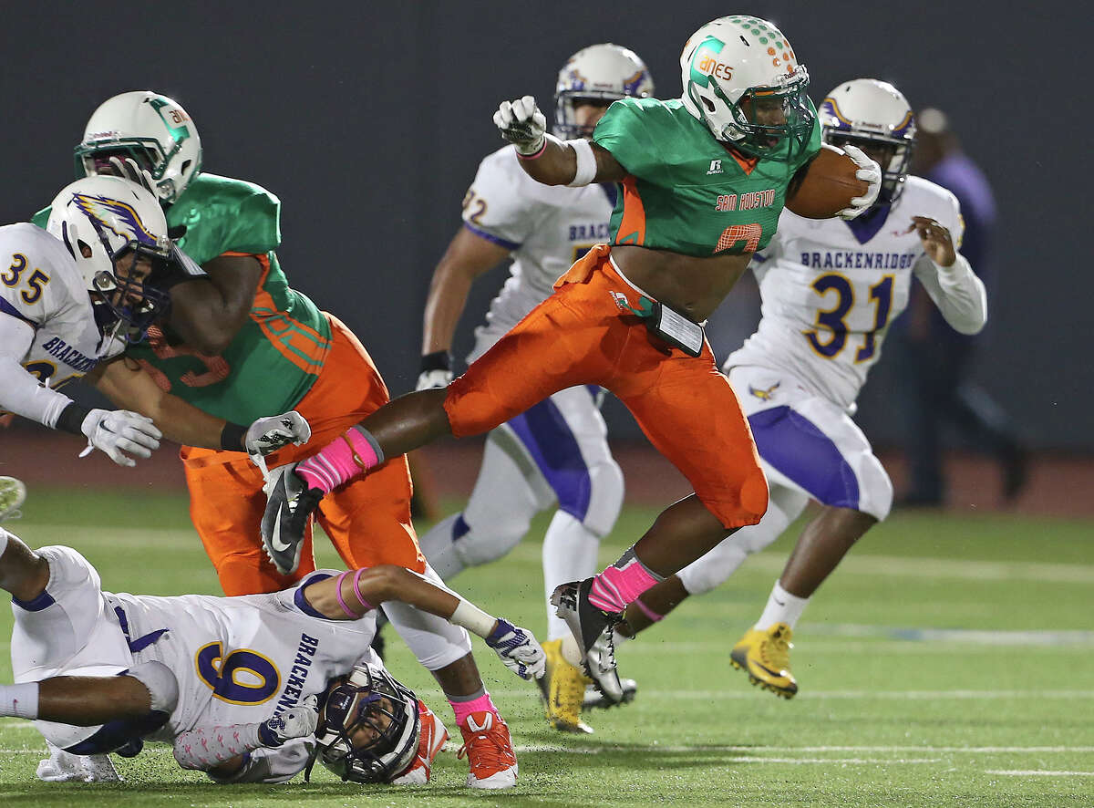 Sam Houston's Dewayne Brown eludes the Brackenridge defense during the Hurricanes' Diestrict 28-5A victory Thursday night at Alamo Stadium. The Canes' Dewayne Brown flies away from tacklers as Brackenridge plays Sam Houston at Alamo Stadium on October 1, 2015.