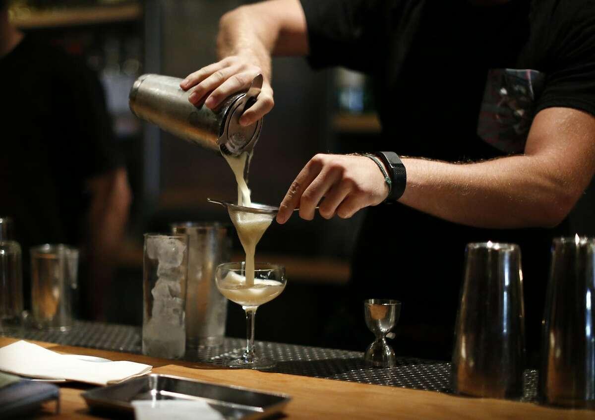 A bartender makes