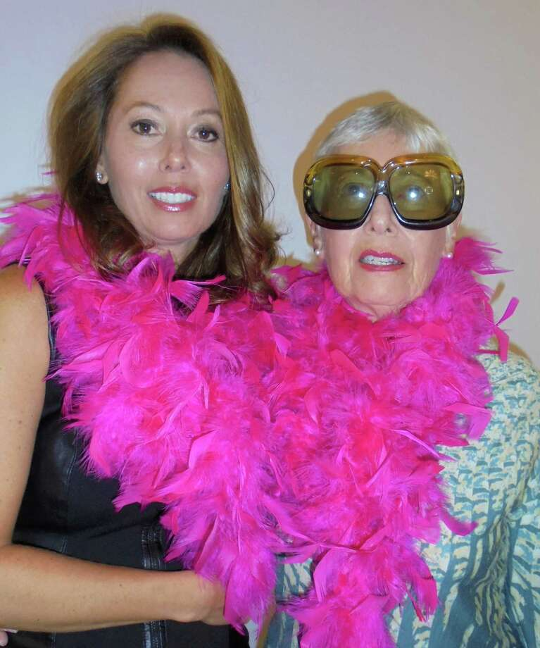 Alison Reilly of Westport, a nine-month breast cancer survivor, poses with her mother Sylvia Lordan, who came from her home in Medford, Mass., to accompany her daughter on the runway for the Pink Aid fashion show that featured 16 survivors; both of them pose in pink feather boas at a feature that was part of this year's 5th annual fundraiser. Photo: Meg Barone / For Hearst Connecticut Media / Westport News