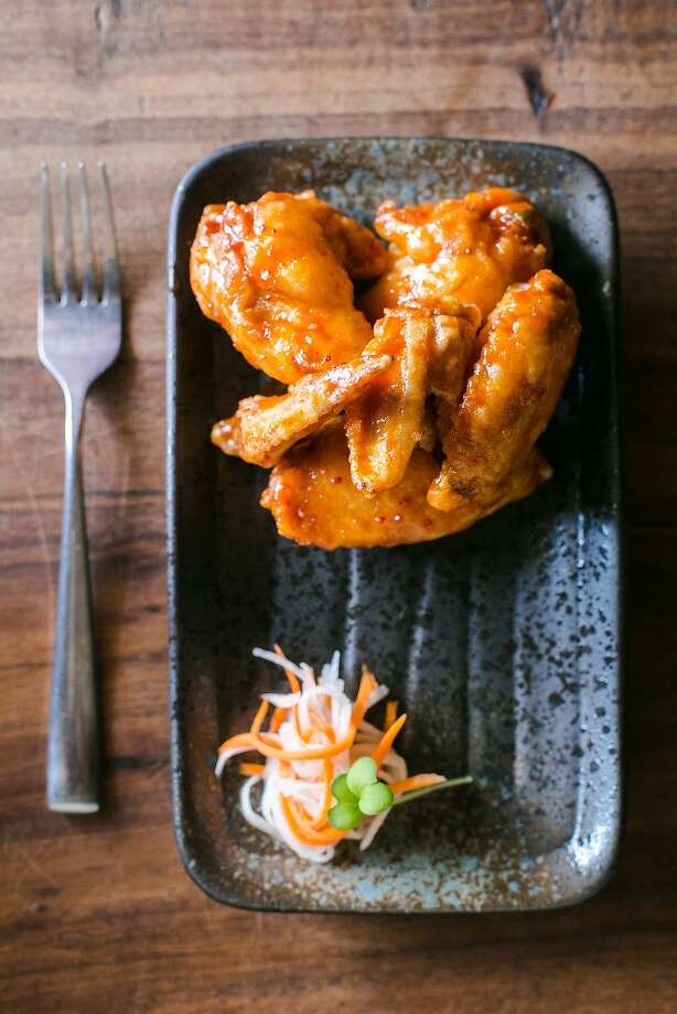 "FuseBOX serves their own version of ""KFC"" with chicken wings dipped in a rice flour batter and covered in a spicy sauce. Photo: Jen Fedrizzi, Special To The Chronicle"