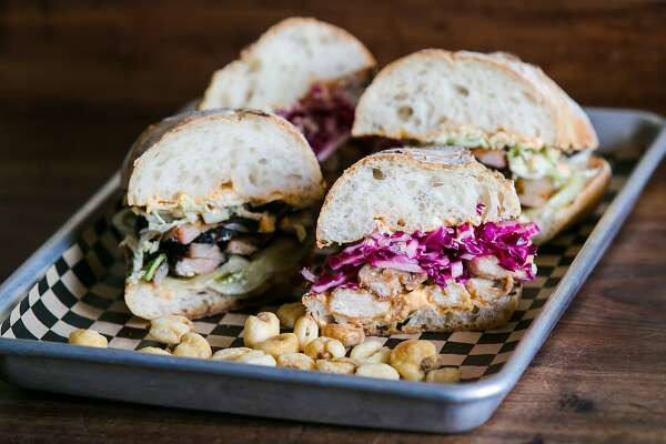 3of29sandwiches at fusebox, like the pork belly or tokyo po boy, are served  with corn nuts photo: jen fedrizzi, special to the chronicle